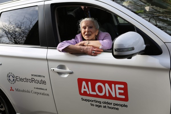 Repro Free: 22nd March 2017. ALONE, the charity that supports older people to age at home, today received a donation of a Mitsubishi Outlander PHEV (Plug-in Hybrid Electric Vehicle) from ElectroRoute, the leading Irish energy trading and services firm, and Mitsubishi Corporation, the global, integrated business enterprise headquartered in Japan. The car will be used by ALONE to provide its befriending, support, advocacy and housing services to older people throughout Ireland. Margaret Dougan, who avails of ALONE's services, is pictured in the new car. Picture Jason Clarke