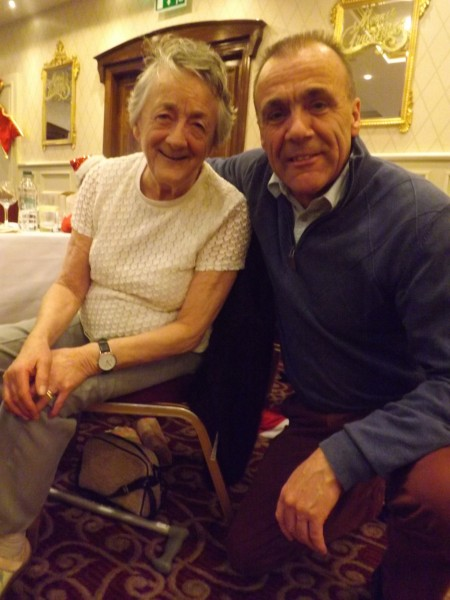 An older person with their befriender, spreading the Christmas joy and enjoying ALONE'S Christmas Dinner Dance 2015.